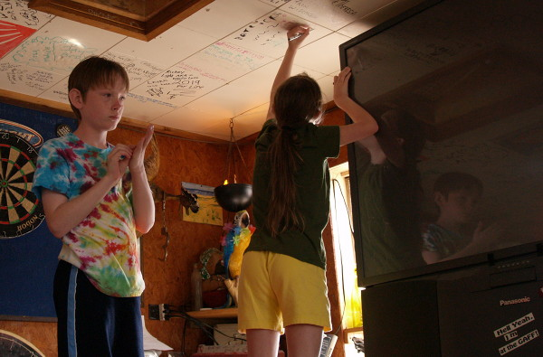 Photo of kids decorating tile
